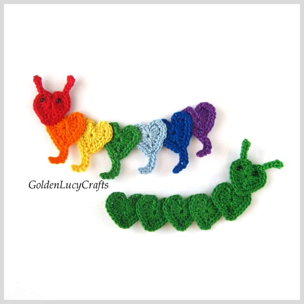 Two crocheted caterpillars applique made from hearts.
