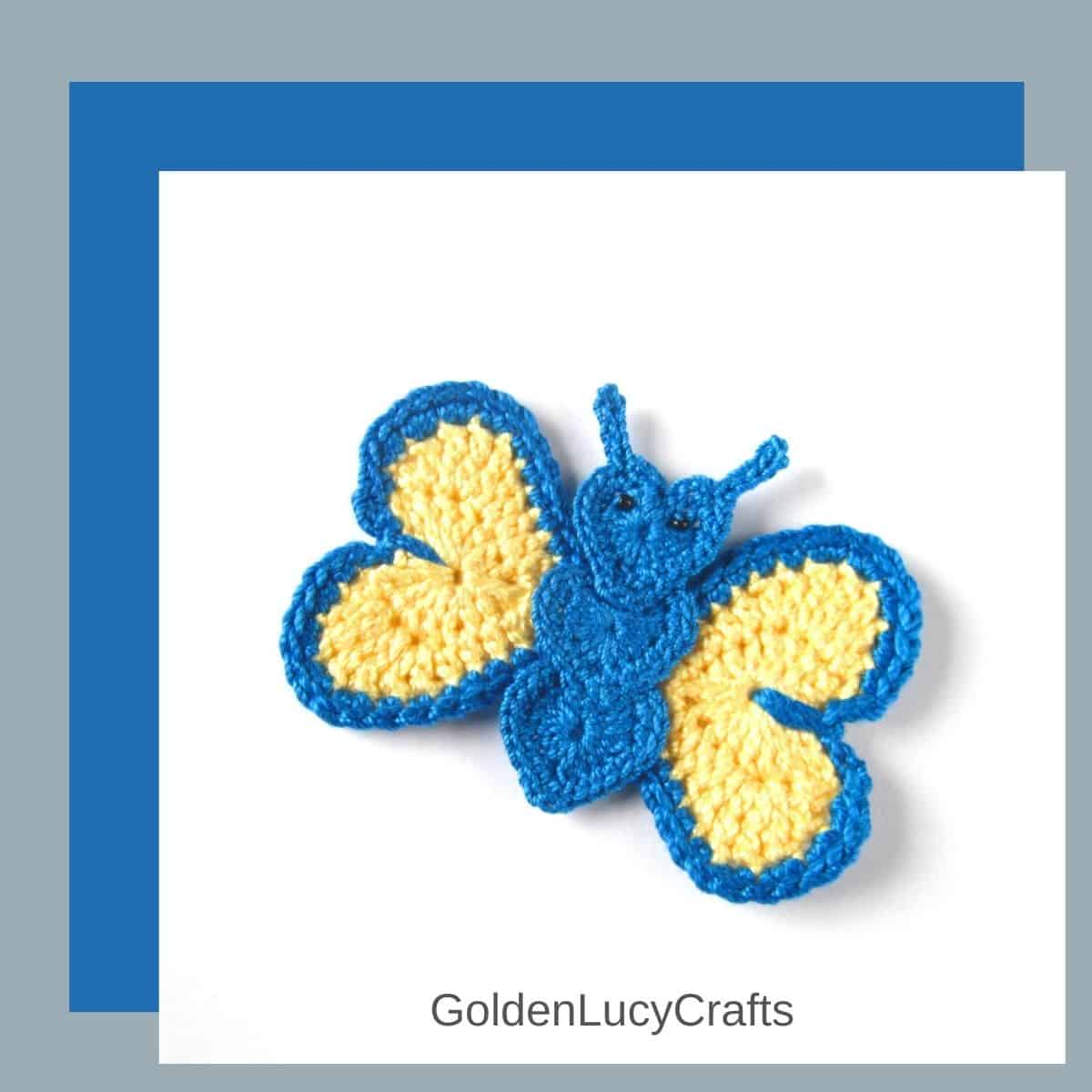 Crochet butterfly applique in blue and yellow colors.