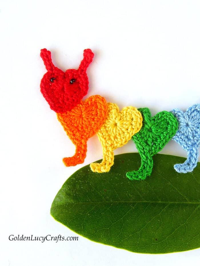 Crochet rainbow caterpillar made from hearts