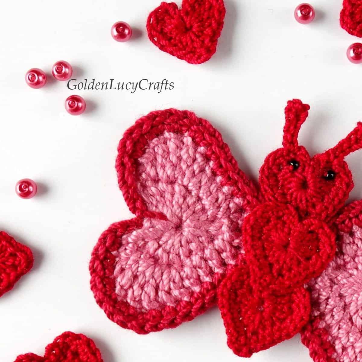 Crochet butterfly applique close up image.