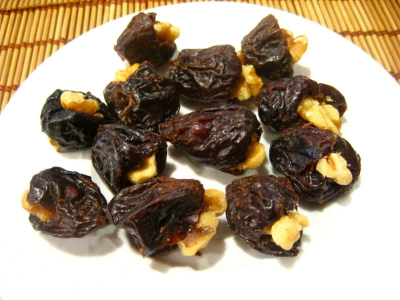 Prunes stuffed with walnuts in sweet cream