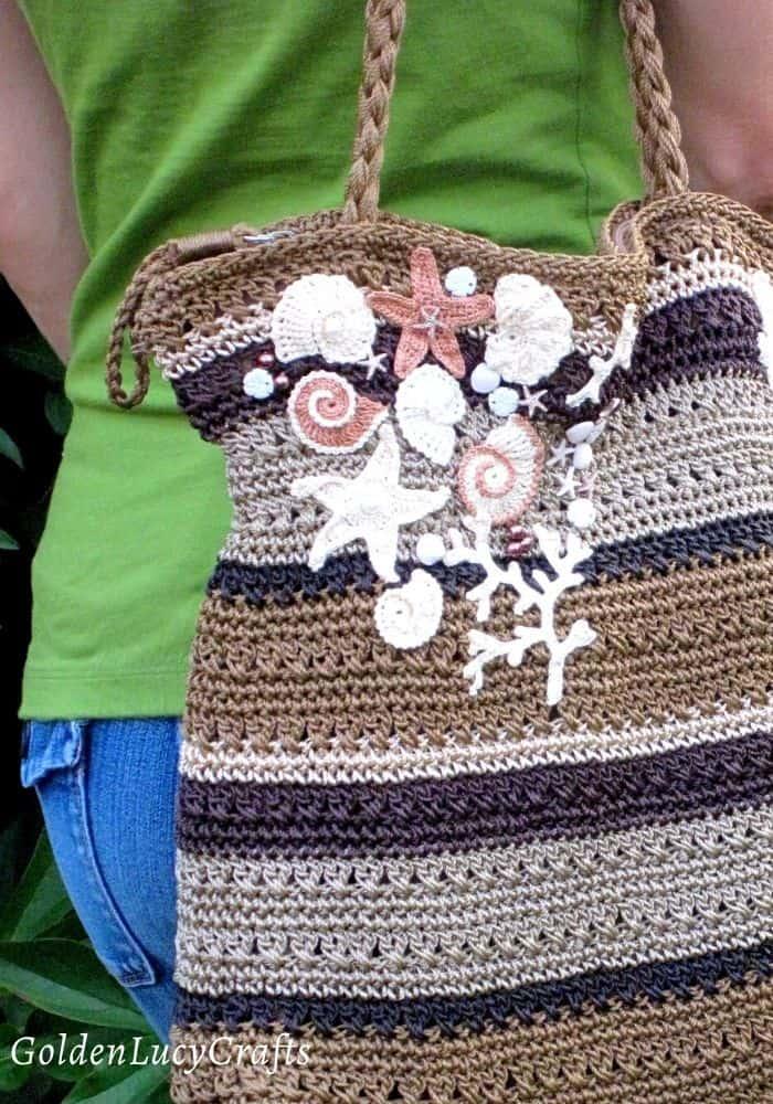 Bag embellished with crochet appliques
