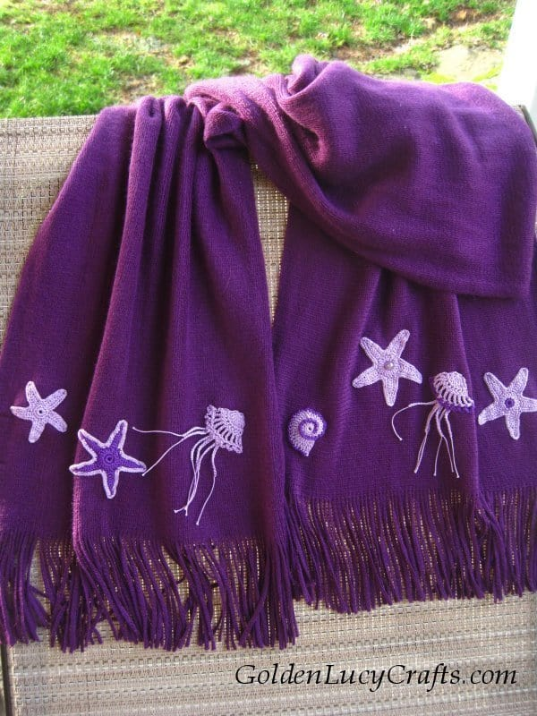 Scarf embellished with crochet appliques