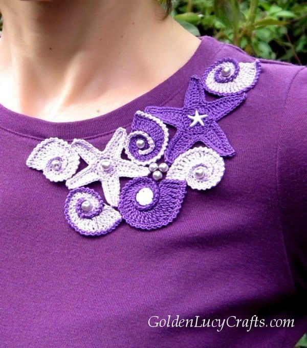 Top embellished with crochet appliques