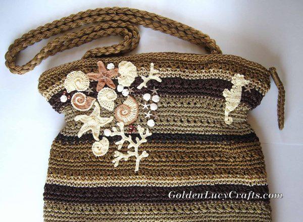 Bag embellished with sea motifs crochet appliques