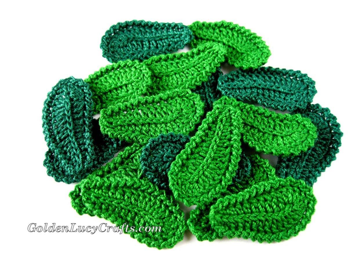 Pile of crocheted green leaves.
