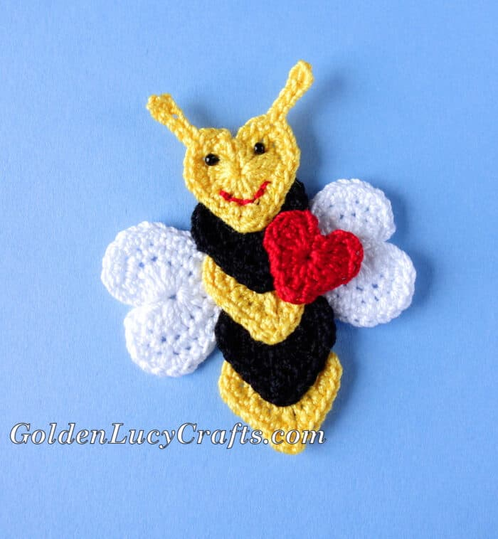 Crochet bee applique made from hearts