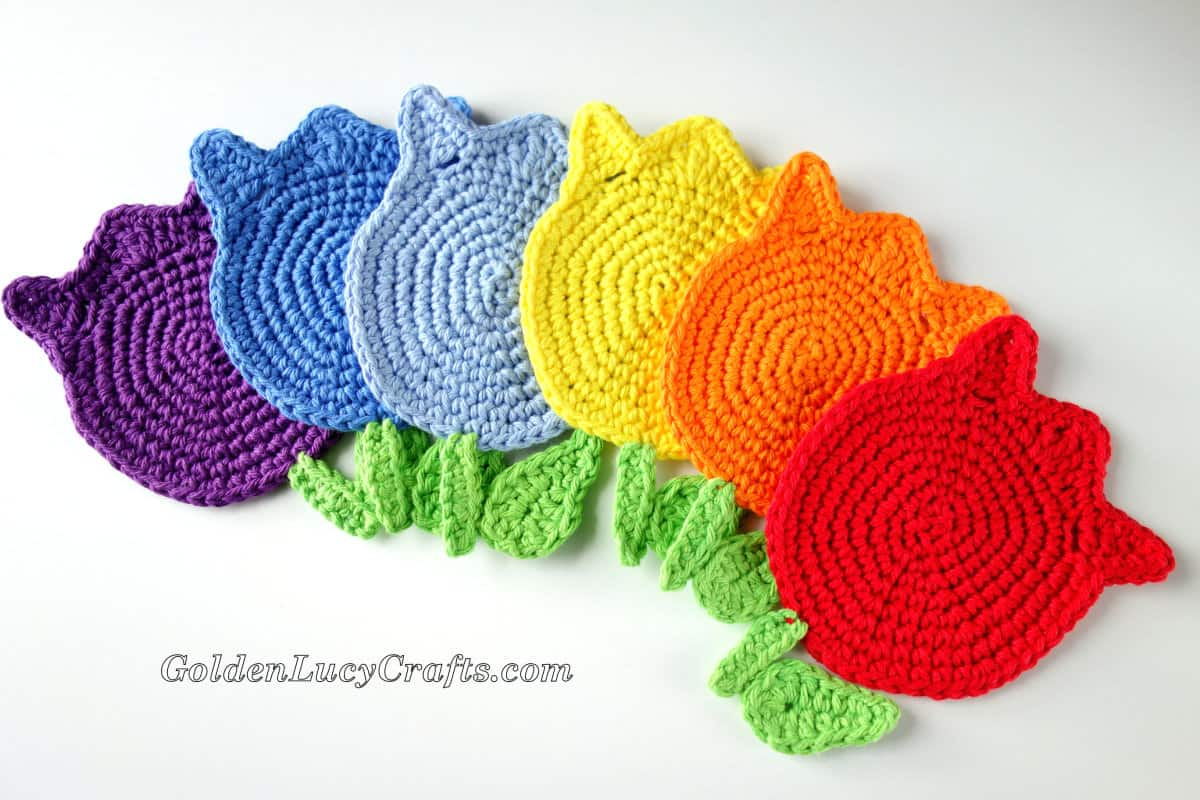 Crocheted tulips in colors of rainbow.
