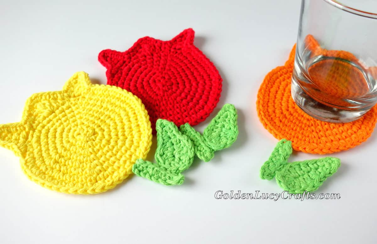 Crocheted tulip coasters and water glass.