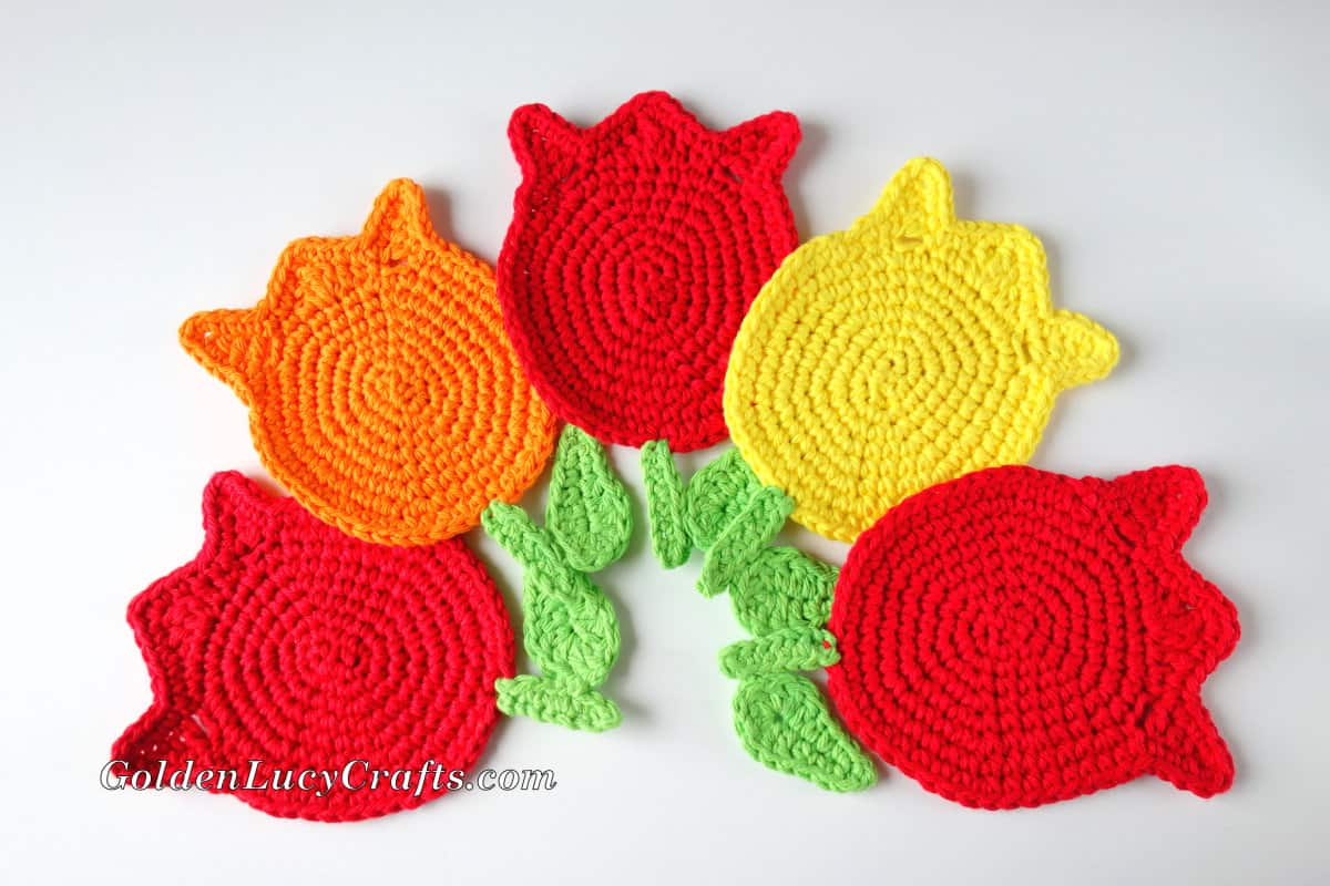 Red, yellow and orange crocheted tulip coasters.