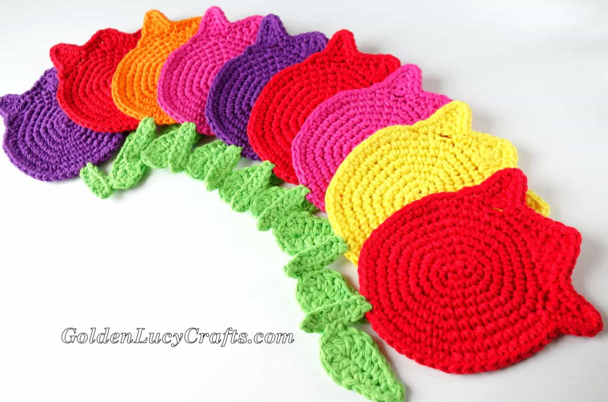 Crocheted tulip coasters in many different colors.