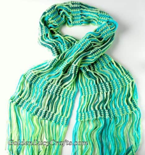 Crocheted scarf  made from yarn in  shades of green and yellow colors.
