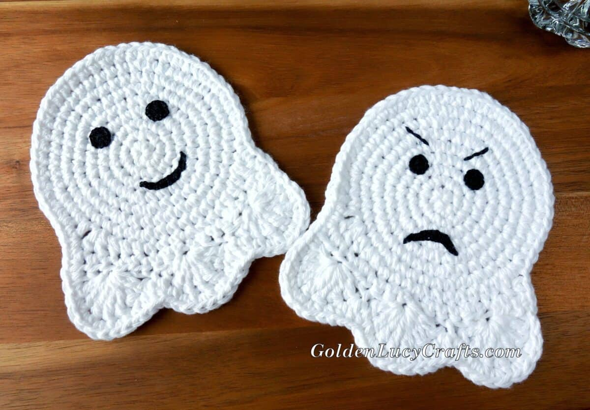 Two crocheted ghost coasters.