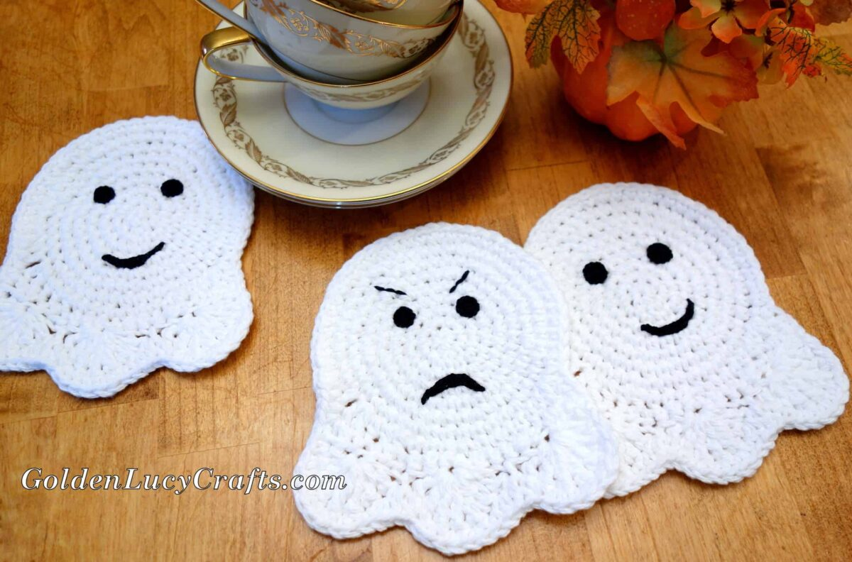 Three crochet Ghost Coasters laying on the table.