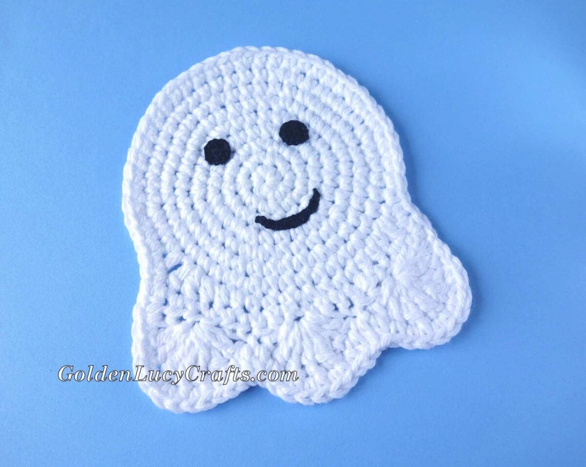 Crochet Ghost Coaster with happy face.