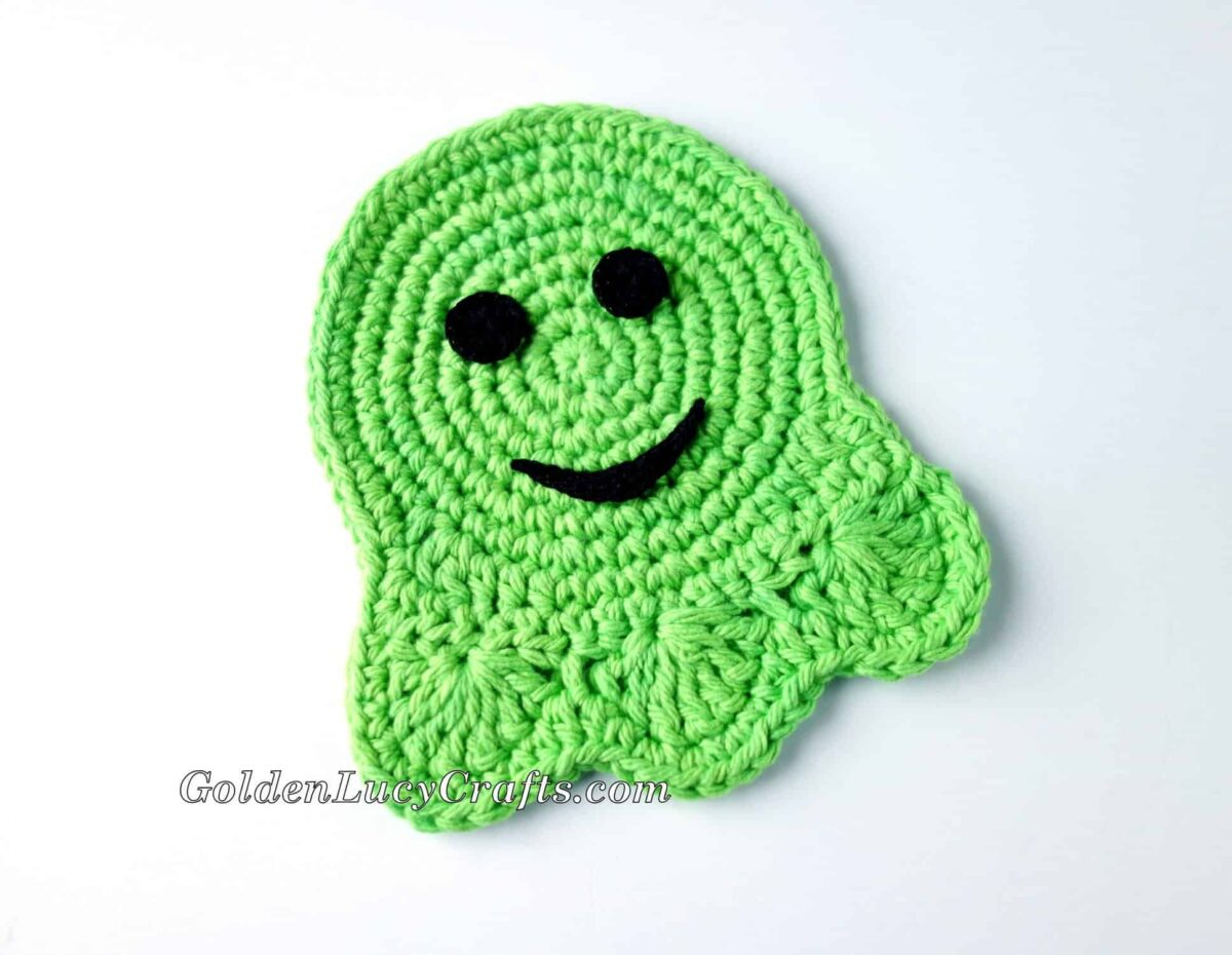 Crochet Ghost Coaster in green color.