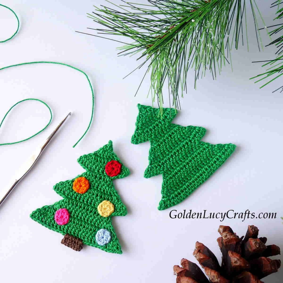 Two crocheted Christmas tree appliques.