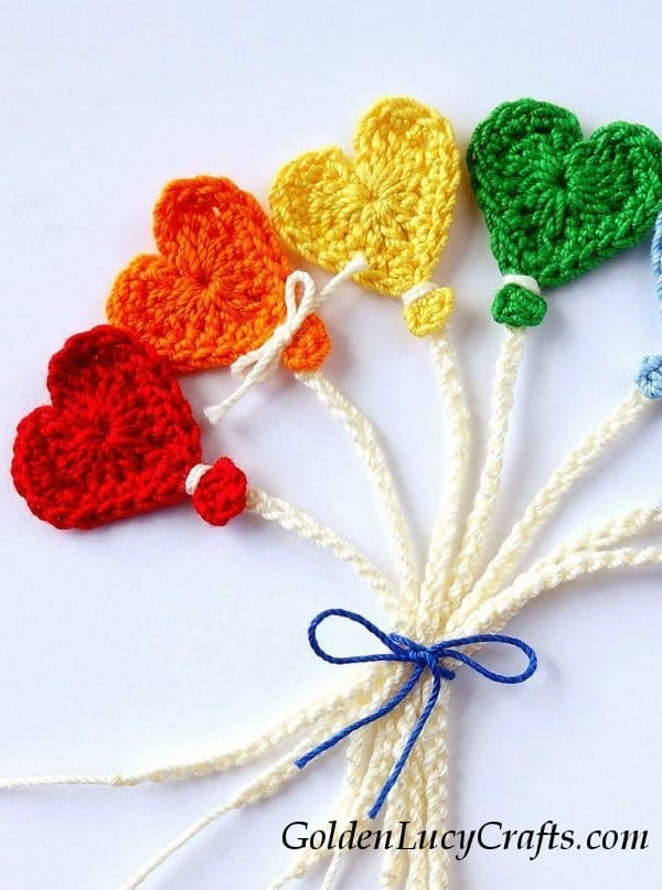 Heart-shaped crocheted balloon appliques, close up image