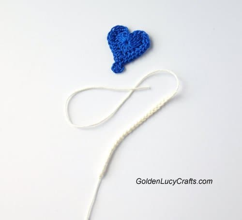 Parts of crocheted heart-shaped balloon - a heart and a string