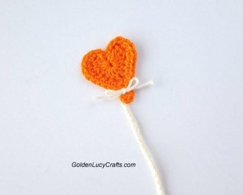 Orange crocheted heart-shaped balloon applique