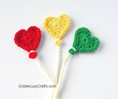 Crochet heart balloon appliques in red, yellow and green