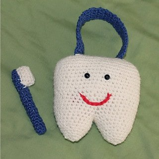 Tooth Fairy Crochet Patterns Roundup - Happy tooth pillow