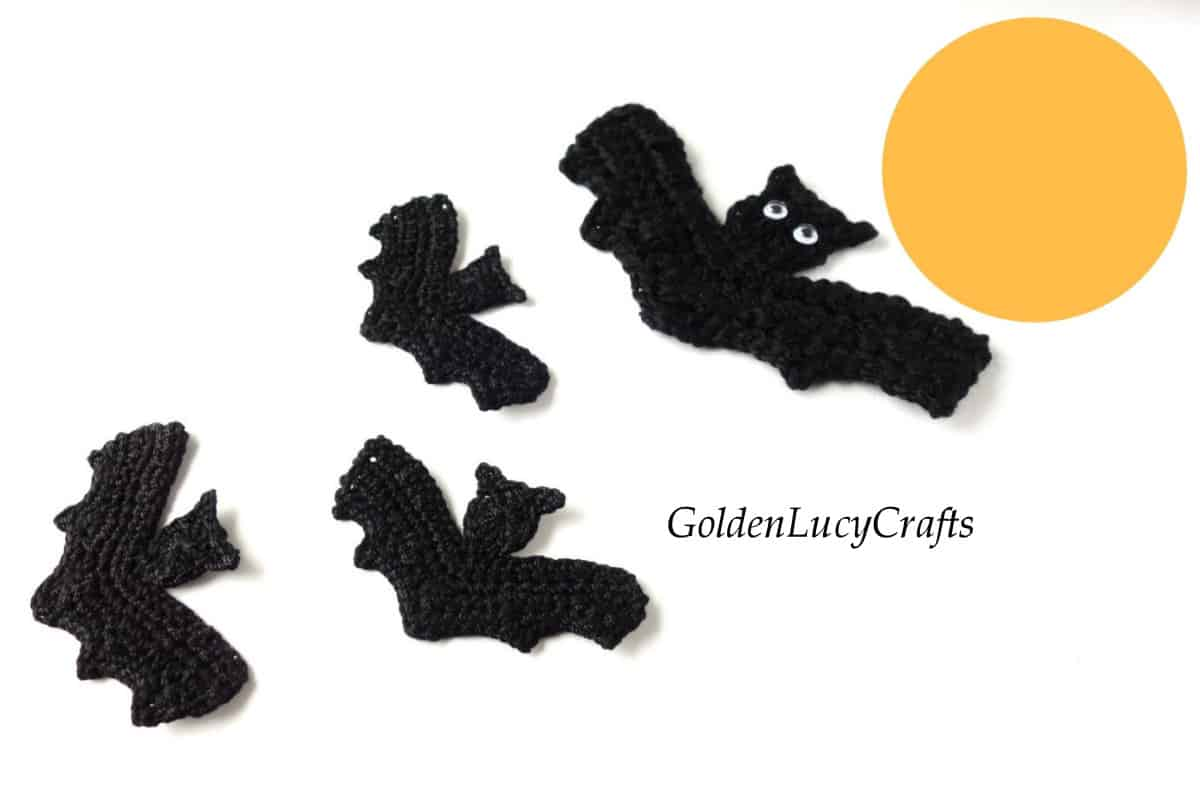 Bats flying to the Moon, crochet appliques.