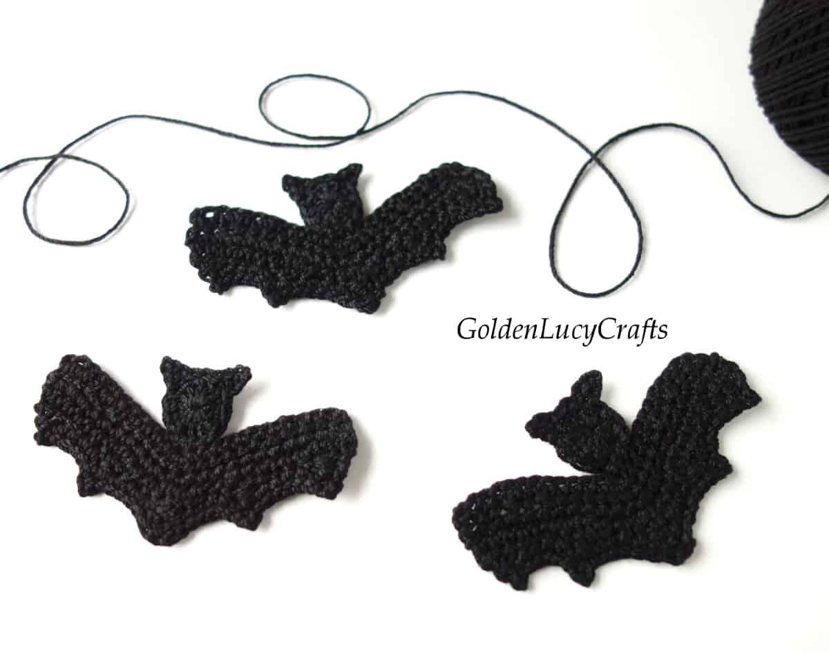 Three black bats crochet applique.