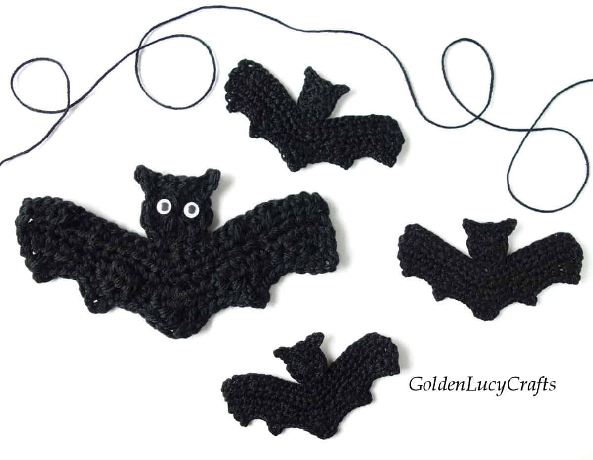 Four crochet bat appliques.