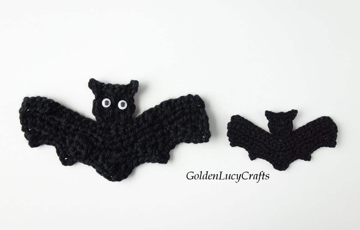 Two crochet bat appliques - large and small.