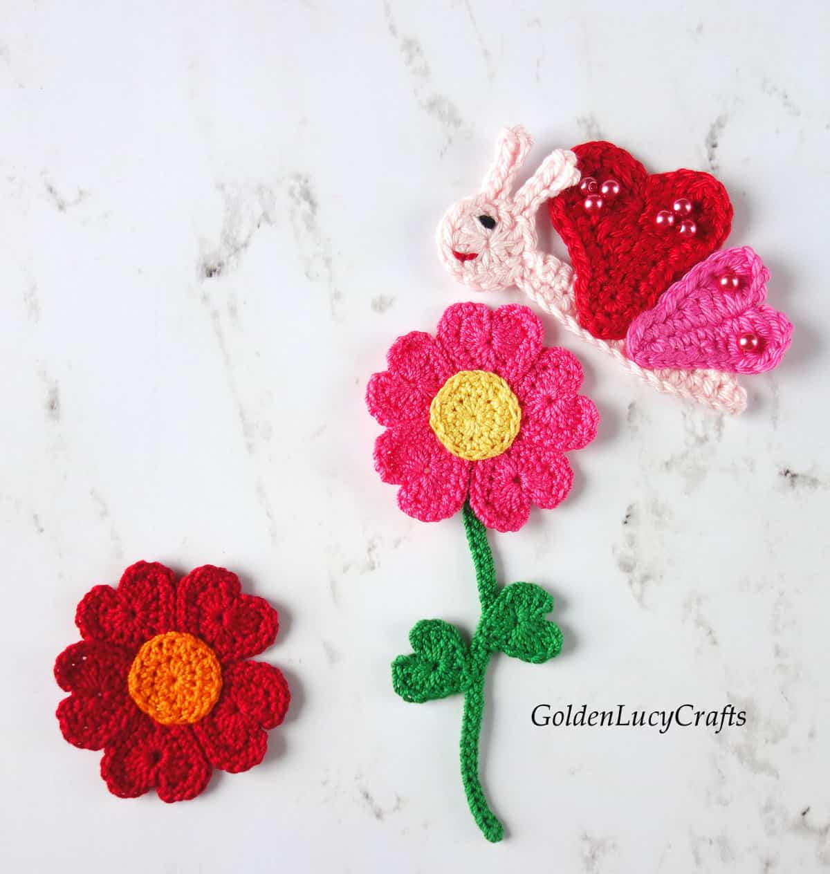 Crochet butterfly and flowers applique.