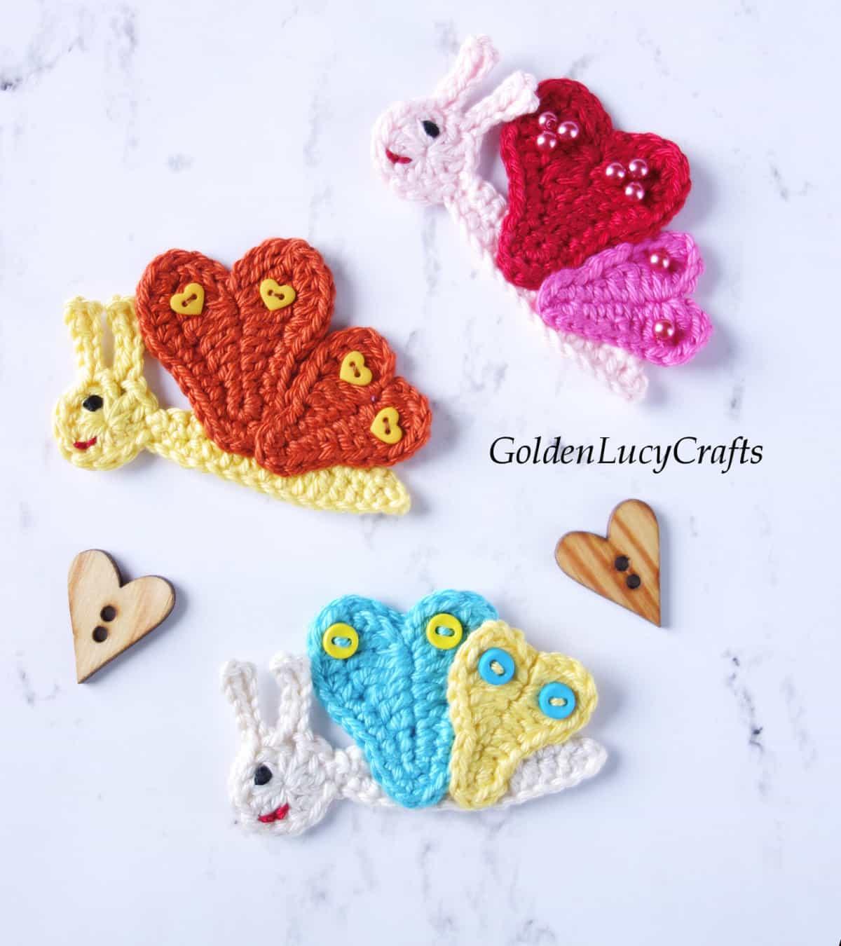 Three crochet butterfly appliques.