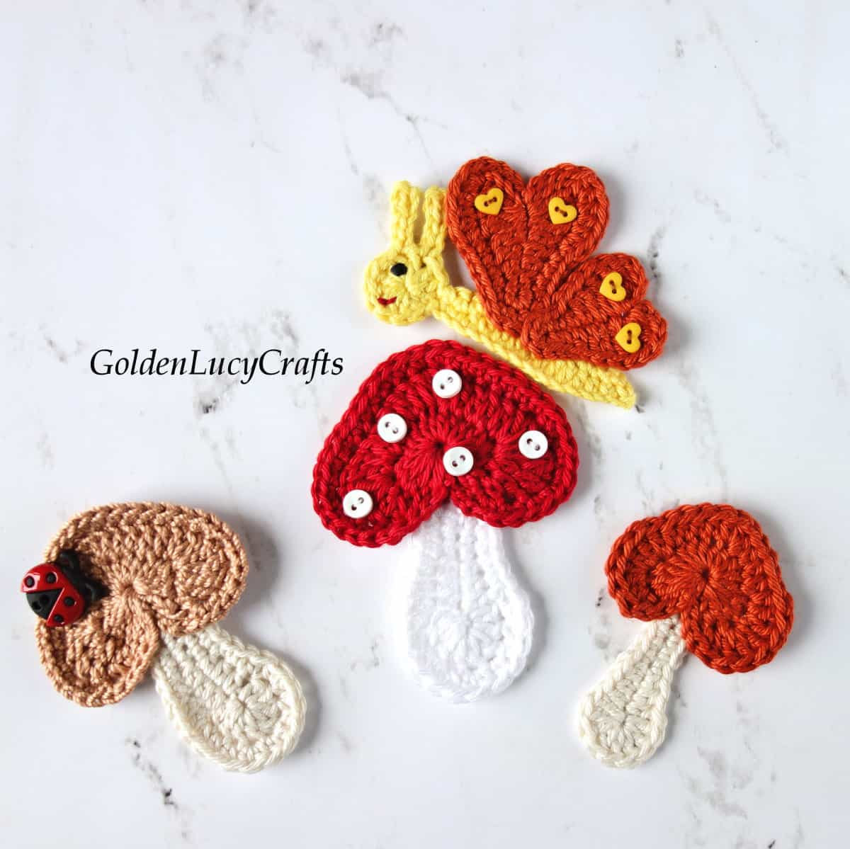 Crochet butterfly and mushrooms applique.