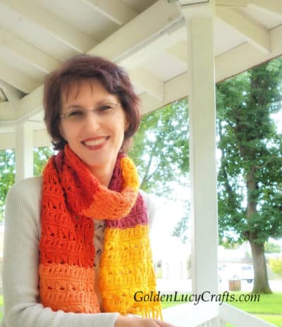 Model is wearing crocheted scarf