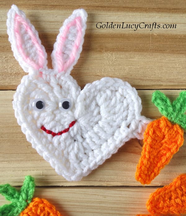 Crochet heart-shaped Easter bunny applique, close up picture.