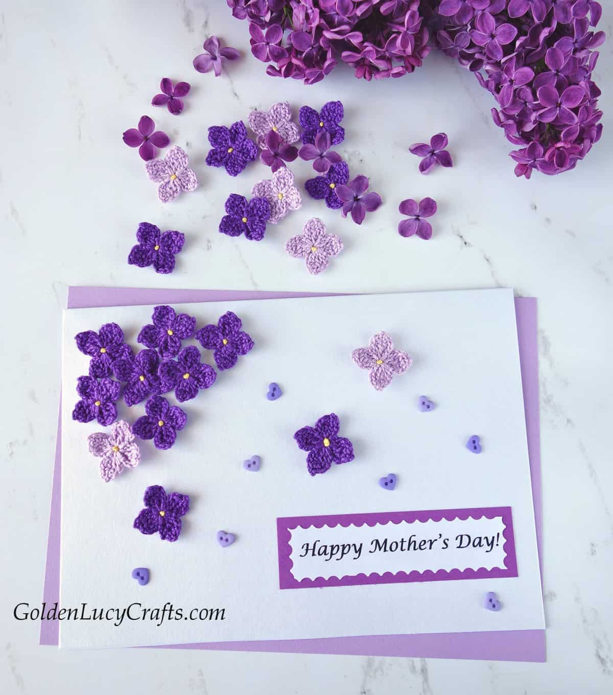 Mother's Day card embellished with crochet lilac flowers, real lilac branch in the background.