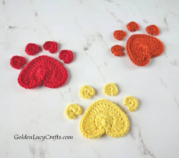 Crochet paw print appliques