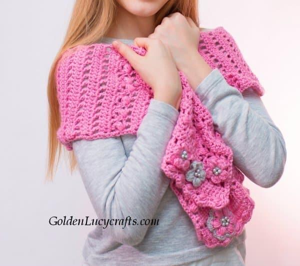 Model is wearing pink scarf