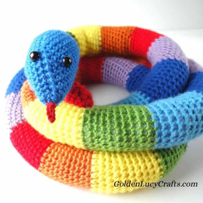 Crocheted rainbow snake.