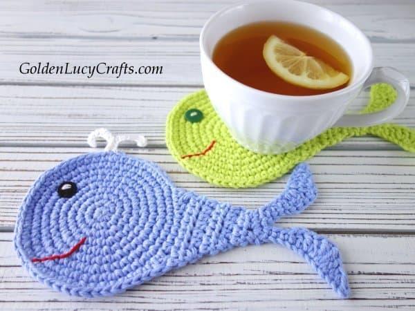 Crochet whale coasters, cup of tea with lemon