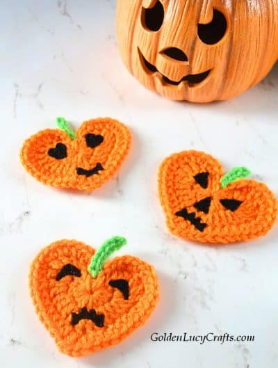 Crochet heart pumpkin appliques.