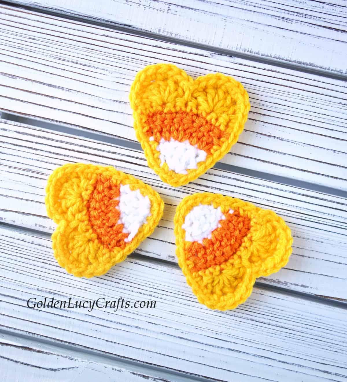Crochet candy corn hearts appliques.