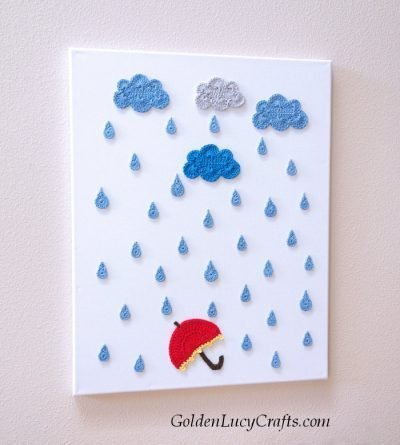Crochet wall art idea - clouds, raindrops and red umbrella.