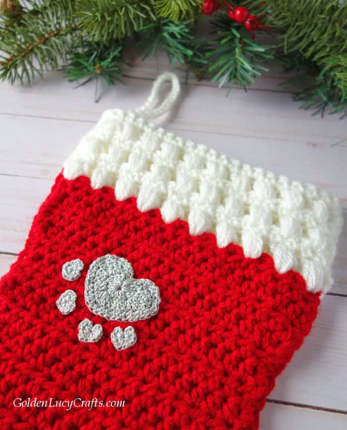 Crochet dog Christmas stocking embellished with heart paw appliques, cat, pets