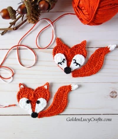 Two crocheted fox appliques.