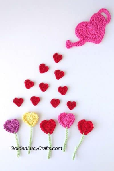 Crochet heart-shaped watering can, small hearts, heart-shaped flowers.