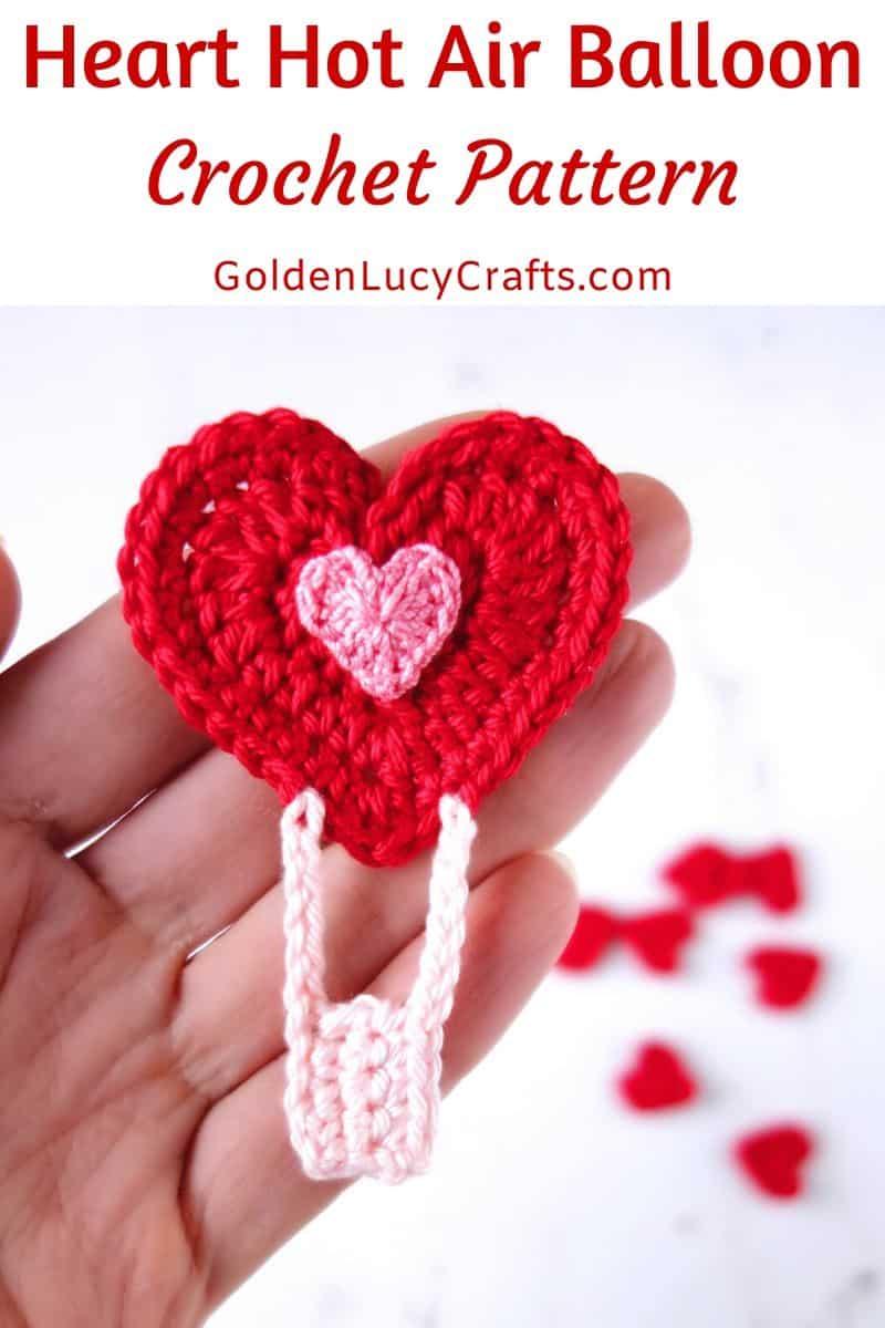 Crochet heart hot air balloon in the palm of a hand
