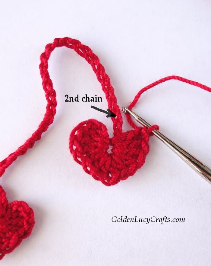 Crocheting into second chain from the center of the heart.