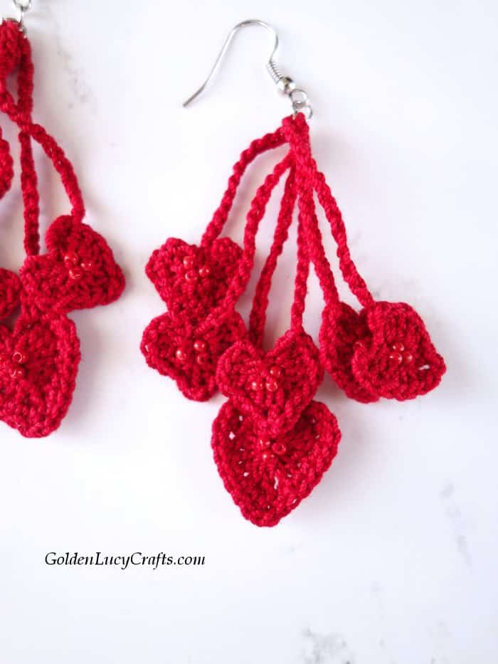 Crochet heart earrings close up image.