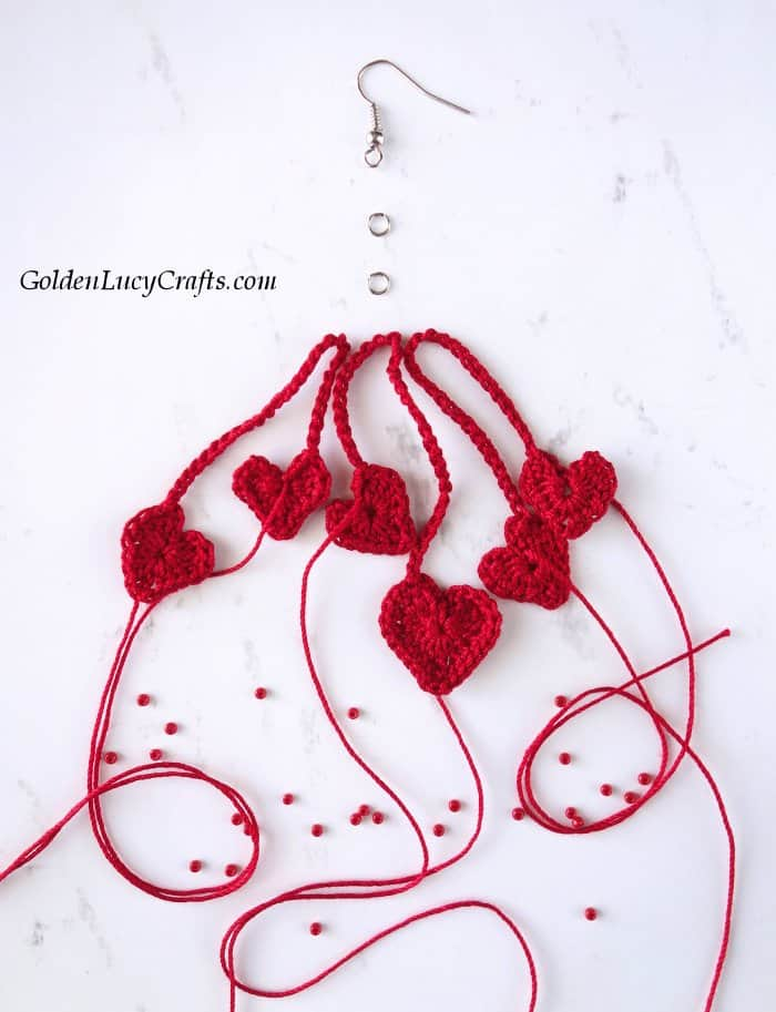 Three pairs of connected crocheted hearts, two jump rings, earring hook.